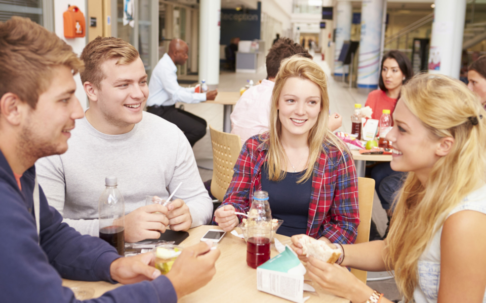 Group Of College Students Eating Lunch Together